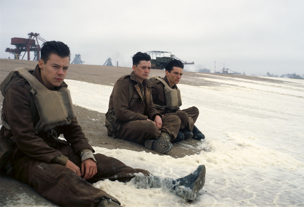 """This image released by Warner Bros. Pictures shows Harry Styles, from left, Aneurin Barnard and Fionn Whitehead in a scene from """"Dunkirk."""" (Warner Bro..."""