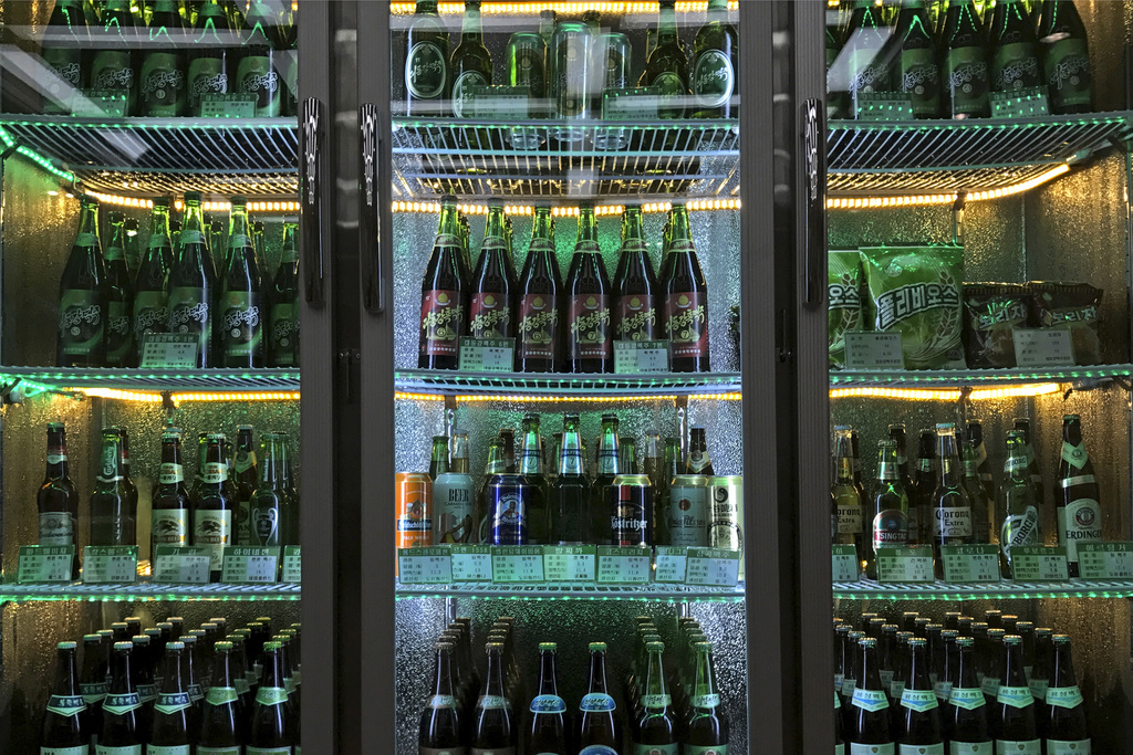 In this Wednesday, July 26, 2017, file photo, samples of different types of Taedonggang beer are displayed in a refrigerator at the Taedonggang Brewer...