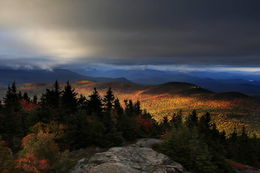FILE - In this Oct. 4, 2016 file photo, fall foliage colors a line of mountains in Chatham, N. H. New England's 2017 fall foliage forecast is very fav