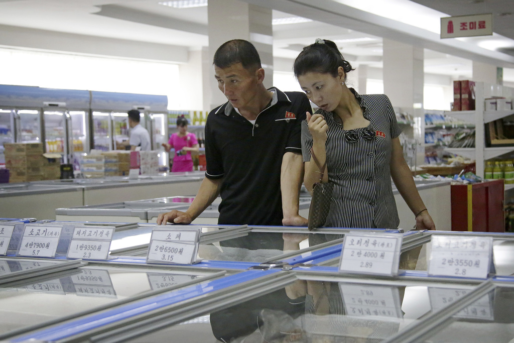 In this Monday, June 19, 2017, photo, a couple browse through the frozen foods section at the Potonggang department store in Pyongyang, North Korea. T...
