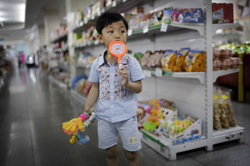 In this Monday, June 19, 2017, photo, a boy stands in the aisle at the Potonggang department store in Pyongyang, North Korea. Three generations into K...