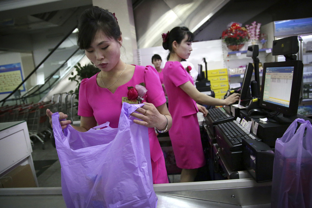 In this Monday, June 19, 2017, photo, cashiers work at the Potonggang department store in Pyongyang, North Korea. Three generations into Kim Jong Un's...