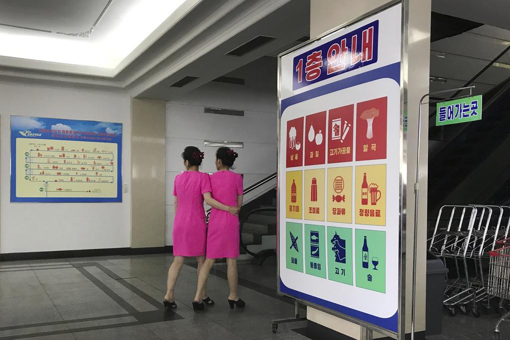 In this Monday, June 19, 2017, photo, staff members walk toward the escalators of the Potonggang department store in Pyongyang, North Korea. Three gen...