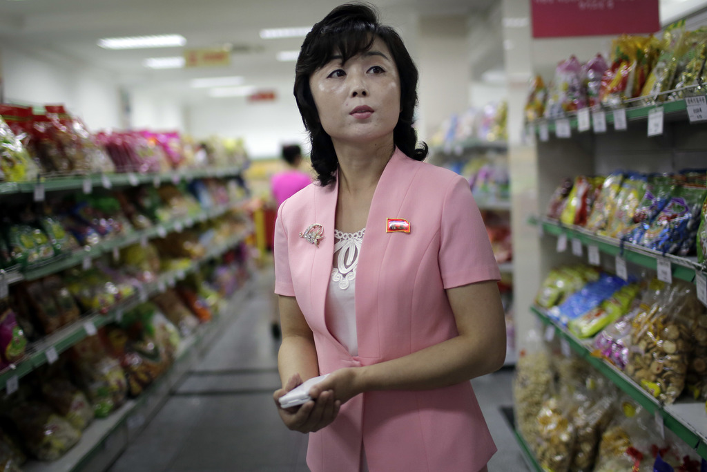In this Monday, June 19, 2017, photo, Song Un Pyol, manager at the Potonggang department store stands in the snacks aisle while being interviewed by T...