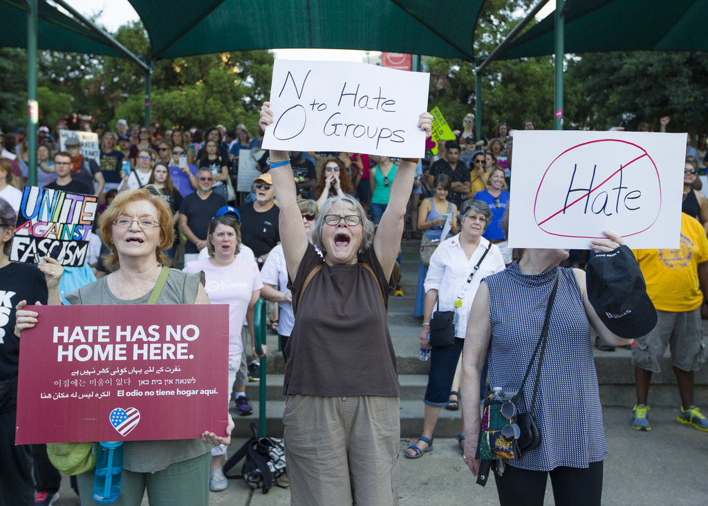 Anti-racism demonstrators participate in a rally that started in Centennial Olympic Park in Atlanta on Saturday, Aug. 19, 2017. Protests took place ac...