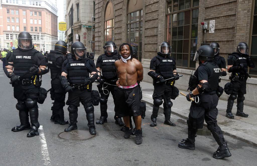 """Police escort away a counterprotester near a """"Free Speech"""" rally staged by conservative activists, Saturday, Aug. 19, 2017, in Boston. An estimated 15"""