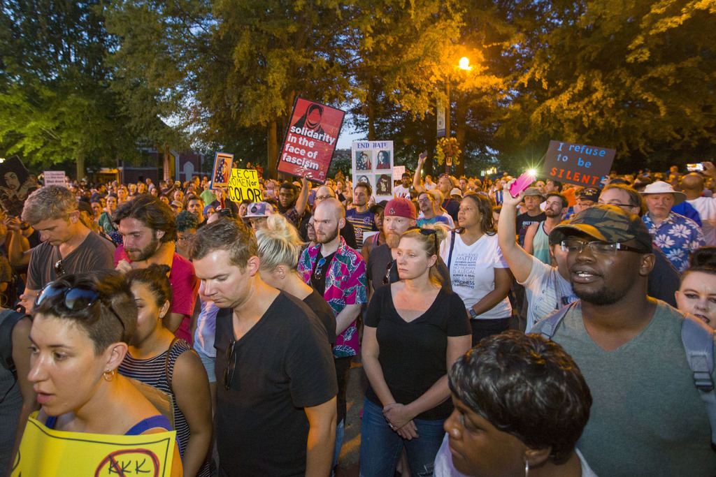 People gather at the King Center after a march by anti-racism demonstrators which started in Centennial Olympic Park in Atlanta on Saturday, Aug. 19, ...