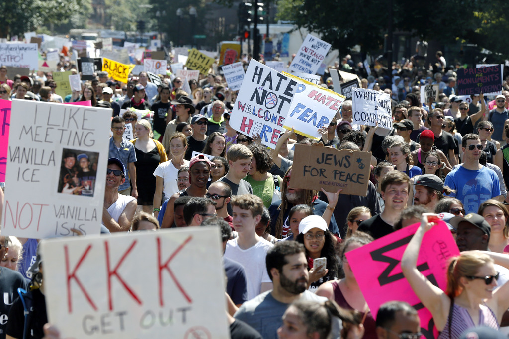 """Counterprotesters stand on the periphery of a """"Free Speech"""" rally staged by conservative activists on Boston Common, Saturday, Aug. 19, 2017, in Bosto"""