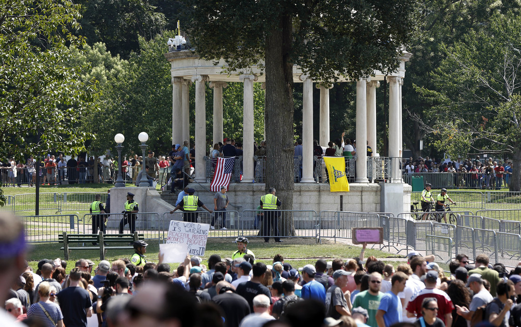 """Organizers stand on the bandstand on Boston Common during a """"Free Speech"""" rally staged by conservative activists, Saturday, Aug. 19, 2017, in Boston."""