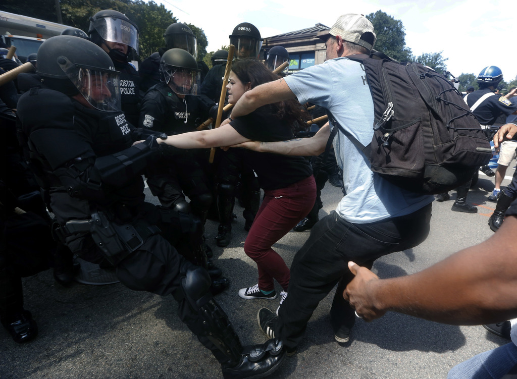"""Police tussle with counterprotesters near a """"Free Speech"""" rally staged by conservative activists, Saturday, Aug. 19, 2017, in Boston.  An estimated 15"""