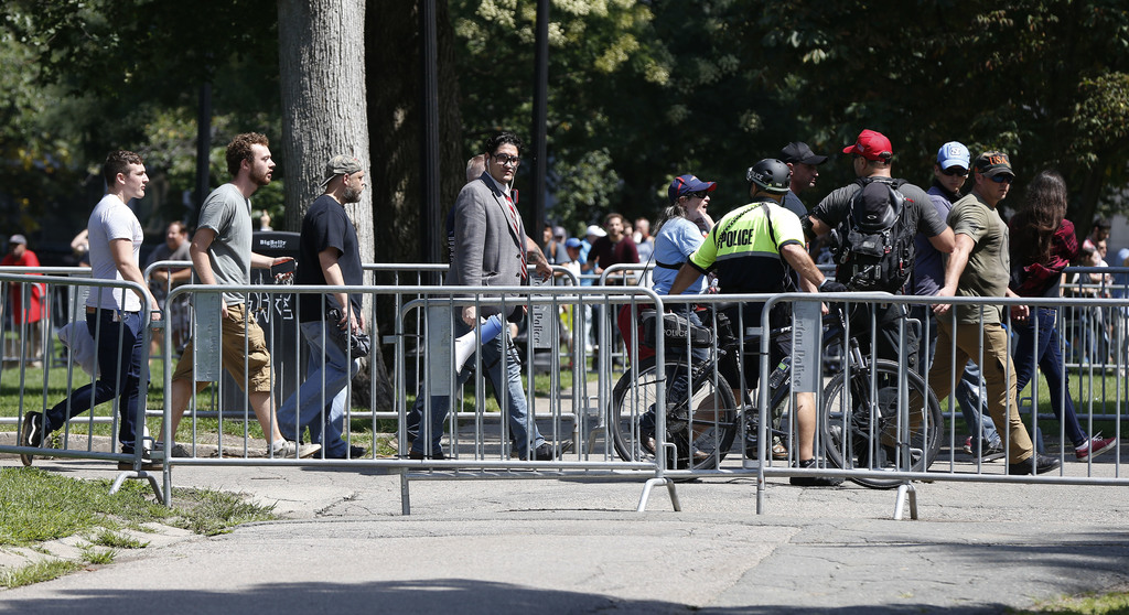 """Organizers depart a """"Free Speech"""" rally staged by conservative activists on Boston Common, Saturday, Aug. 19, 2017, in Boston.  One of the planned spe"""