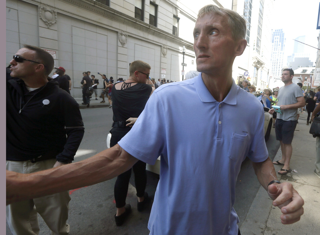 """Boston Police Commissioner William Evans watches counterprotesters near a """"Free Speech"""" rally staged by conservative activists, Saturday, Aug. 19, 201"""