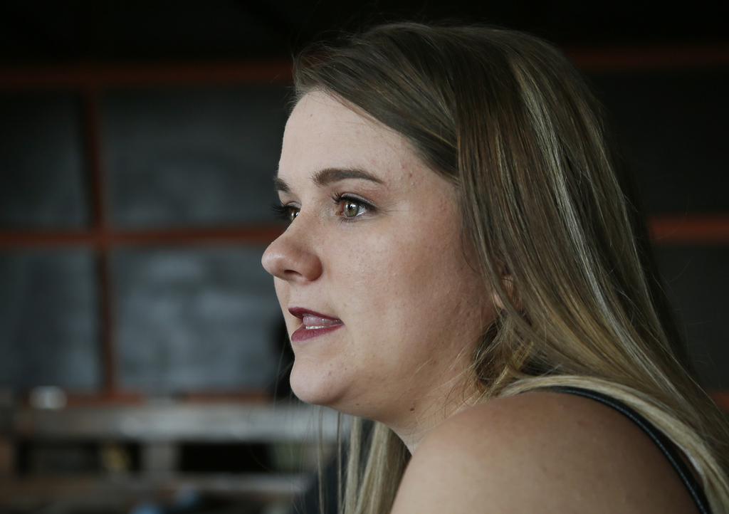 In this Wednesday, Aug. 9, 2017 photo, Danyelle Dyer talks during an interview in Edmond, Okla. Dyer had to obtain a court order after the man who mol...