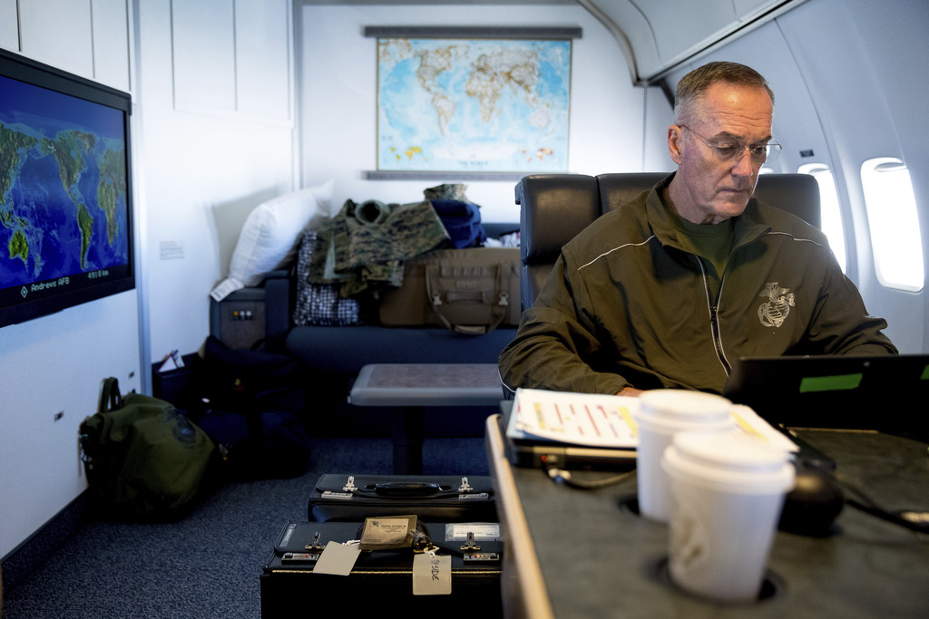 Joint Chiefs Chairman Gen. Joseph Dunford works in his private cabin aboard his plane, Saturday, Aug. 19, 2017, while traveling to Andrews Air Force B...