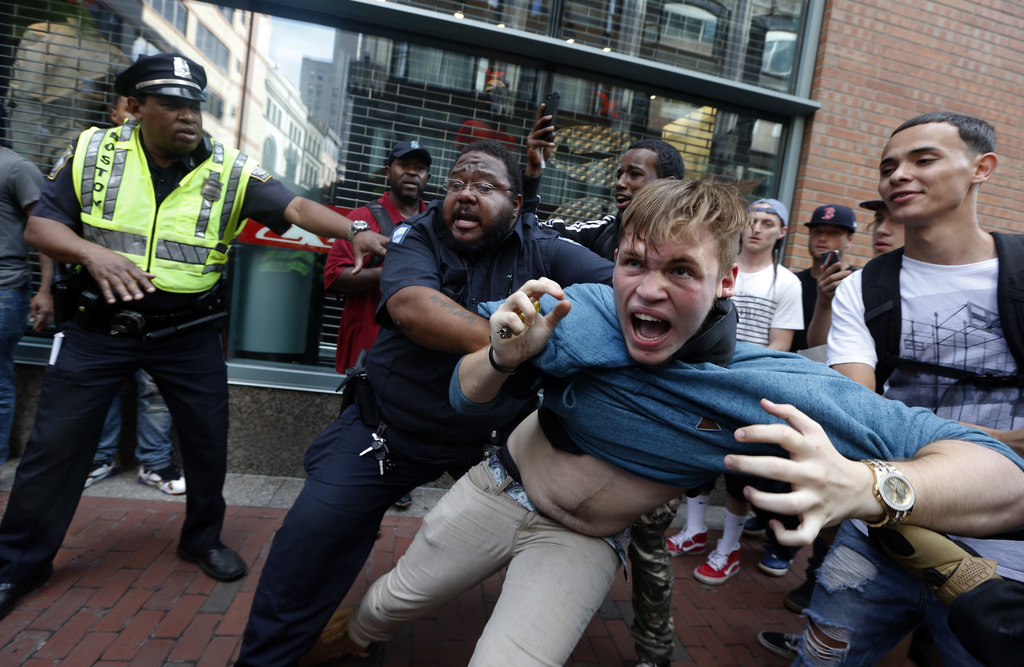 """A counterprotester, part of a small group who remained on the street hours after a """"Free Speech"""" rally was staged by conservative activists, scuffles ..."""