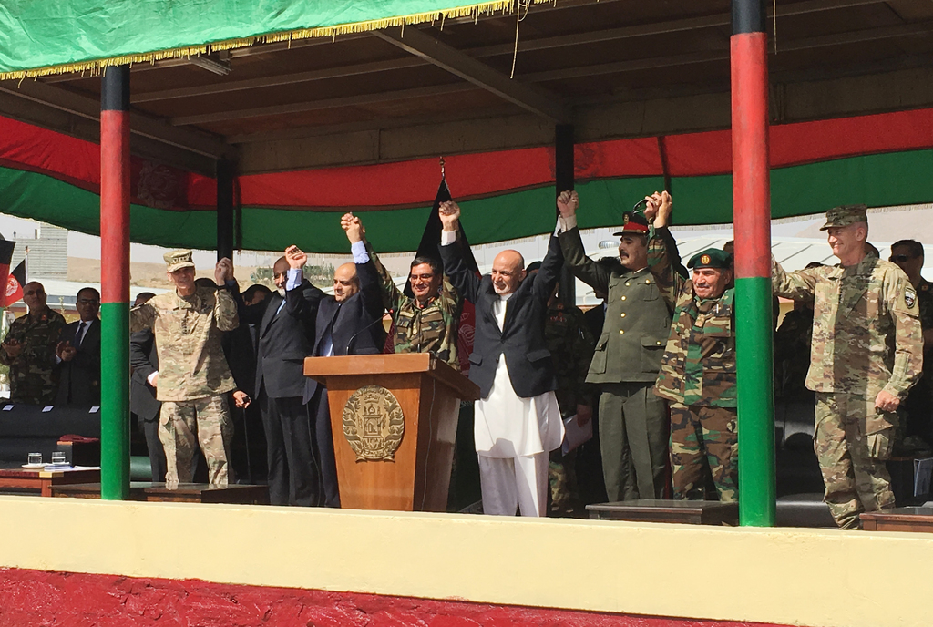 Afghan President Ashraf Ghani, to the right of the podium, is joined by top U.S. and Afghan military leaders for the launch of the Afghan Army's new s...