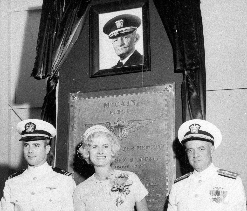 FILE - In this July 14, 1961, file photo, then Lt. John S. McCain III, left, and his parents, Rear Adm. John S. McCain Jr. and Roberta Wright McCain t...