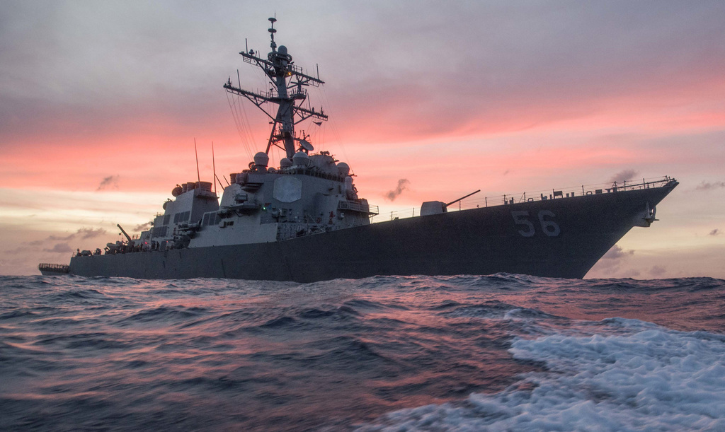 In this Jan. 22, 2017, photo provided by U.S. Navy, the USS John S. McCain conducts a patrol in the South China Sea while supporting security efforts ...