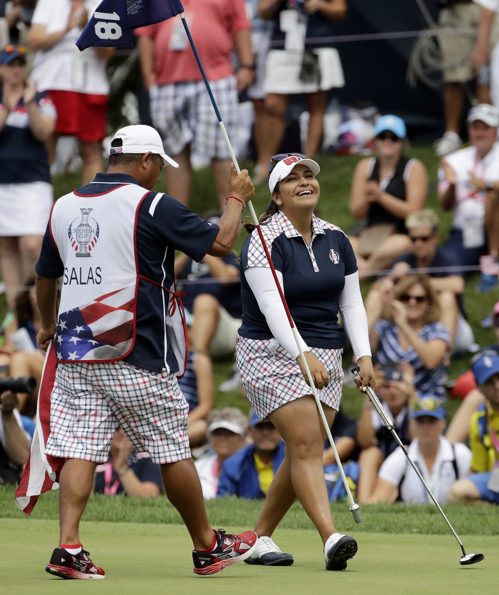 United States' Lizette Salas, left, celebrates after clinching the winning half point during her singles match against Europe's Jodi Ewart Shadoff, of...