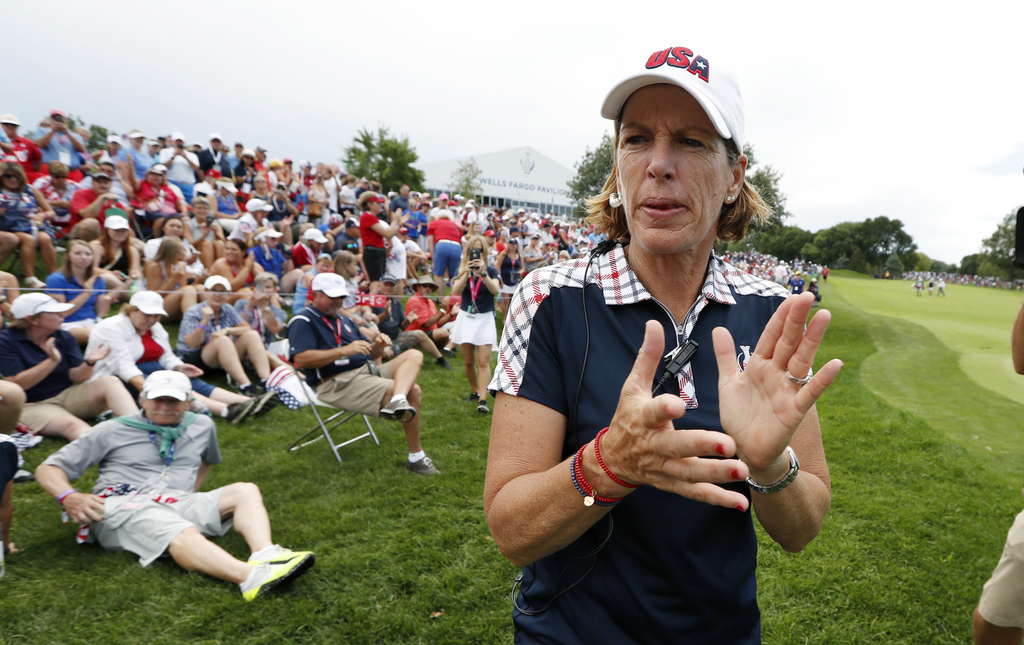 United States captain Juli Inkster celebrates with fans during singles match play in the Solheim Cup golf tournament, Sunday, Aug. 20, 2017, in West D...