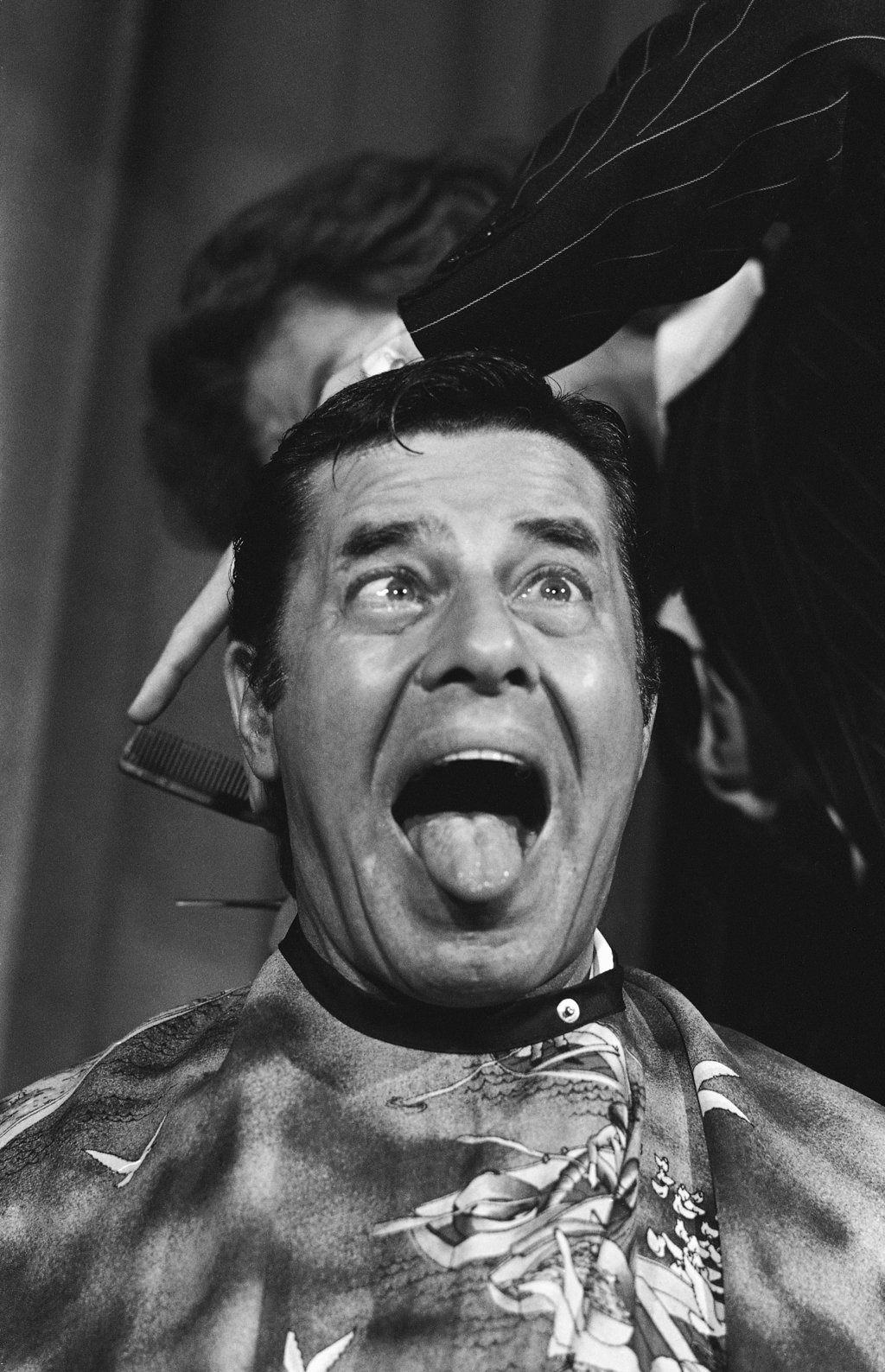 FILE - In a Oct. 16, 1977 file photo, comedian Jerry Lewis cuts up during a haircut for the Muscular Dystrophy Association. Lewis was given a $250,000...