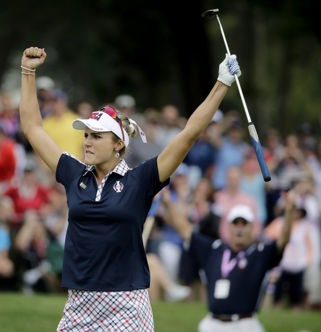 United States' Lexi Thompson celebrates after winning the 15th hole against Europe's Anna Nordqvist, of Sweden, during their singles match in the Solh...