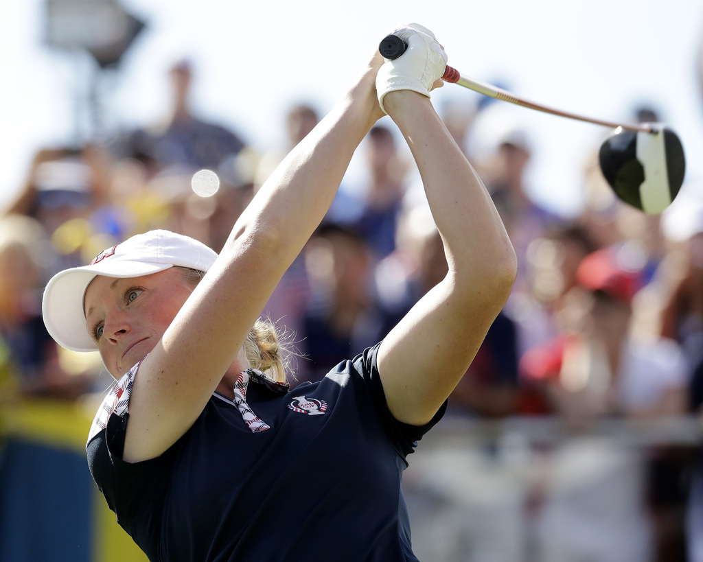 United States' Stacy Lewis tees on the first hole during her singles match against Europe's Catriona Matthew, of Scotland, in the Solheim Cup golf tou...