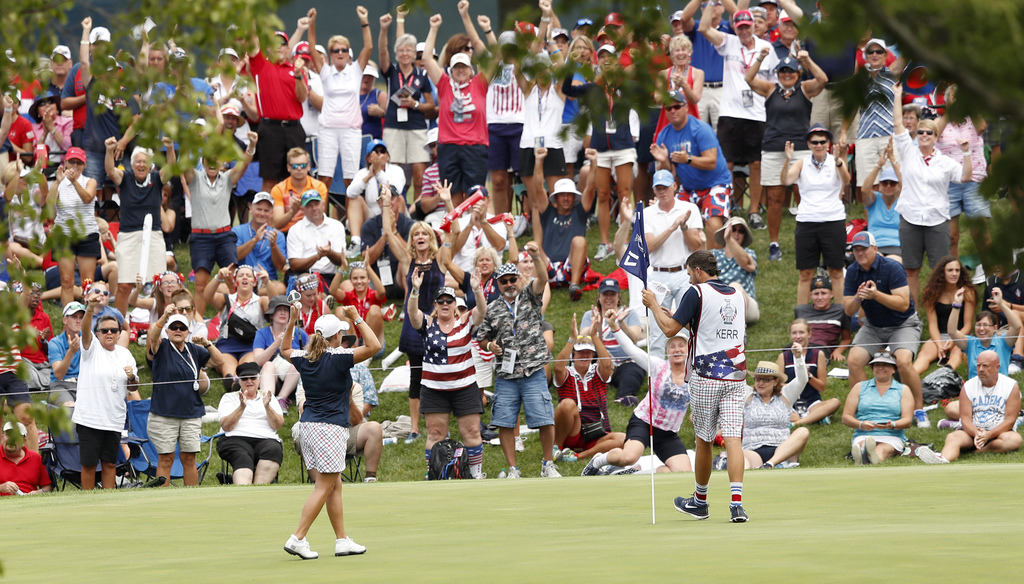 United States' Cristie Kerr celebrates after her singles match against victory in the Solheim Cup golf tournament, Sunday, Aug. 20, 2017, in West Des ...