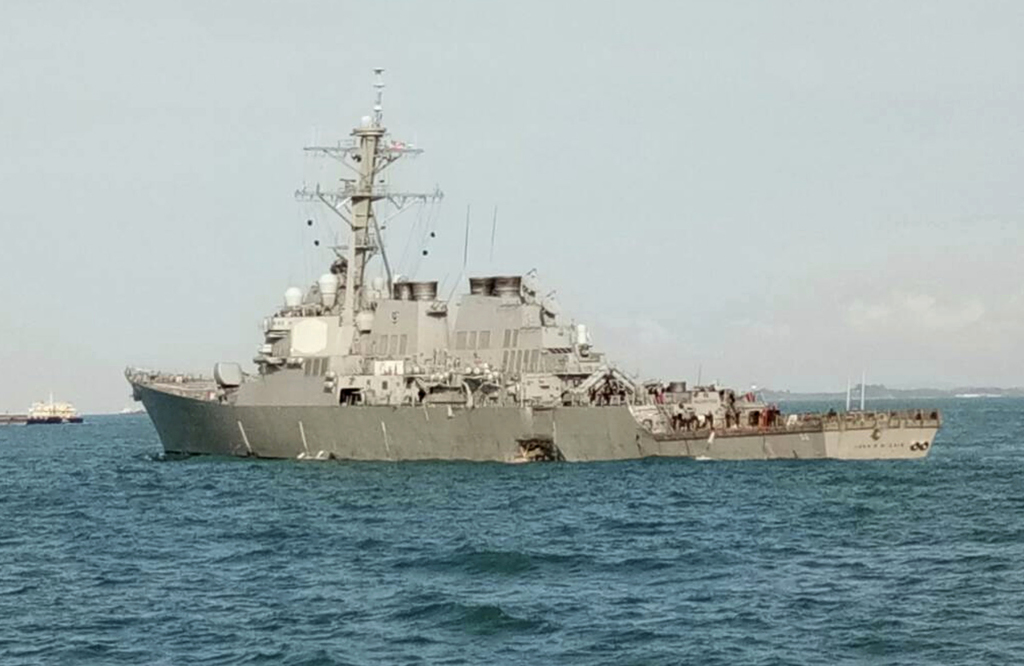 In this photo released by the Royal Malaysian Navy,  the U.S guided-missile destroyer USS John S. McCain is seen after a collision, off Johor, Malaysi...