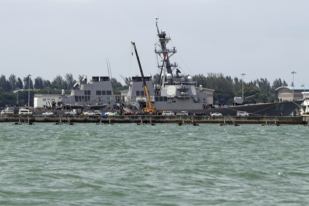 The USS John S. McCain is seen docked at Changi naval base after its accident Monday, Aug. 21, 2017 in Singapore. The USS John S. McCain was docked at...