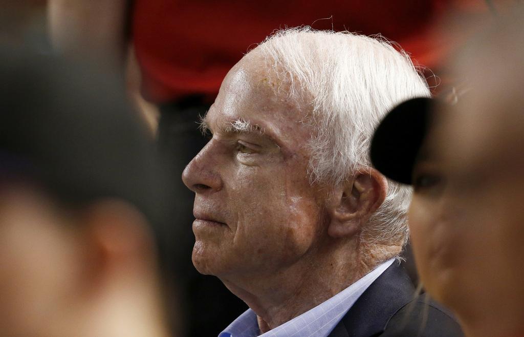 FILE - In this Aug 10, 2017, file photo, Sen. John McCain, R-Ariz., watches a baseball game between the Arizona Diamondbacks and the Los Angeles Dodge...