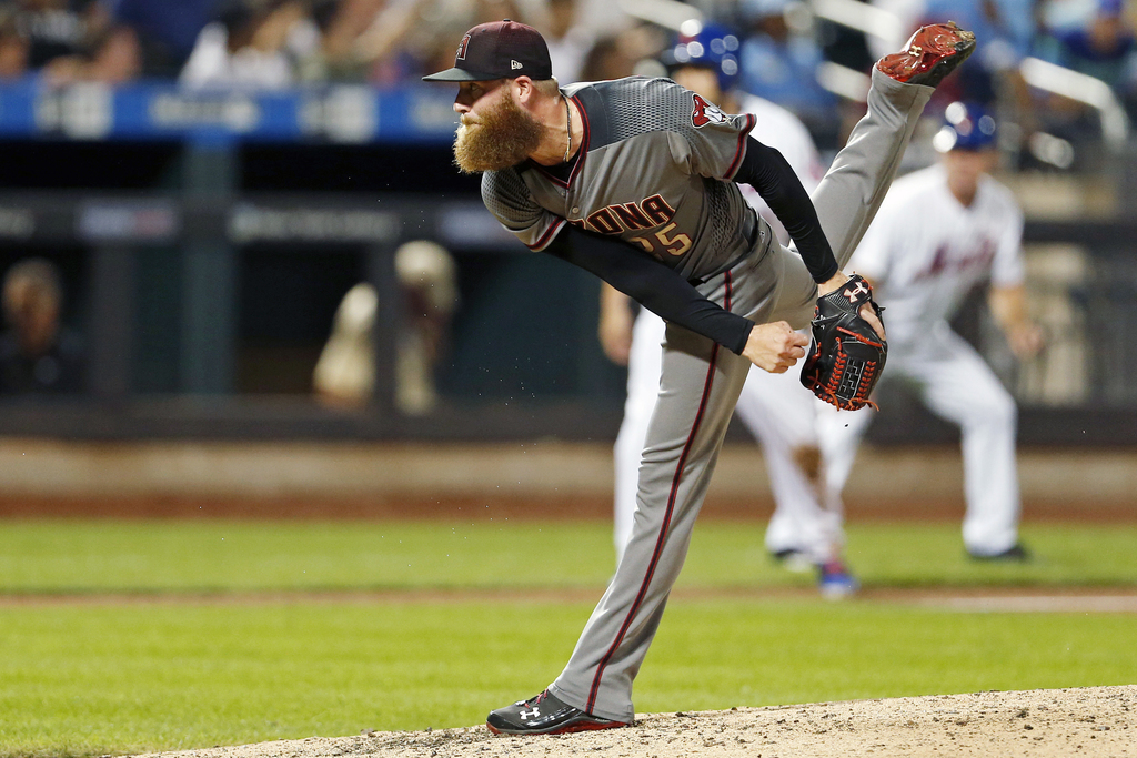 Arizona Diamondbacks pitcher Archie Bradley delivers during the seventh inning of a baseball game against the New York Mets on Monday, Aug. 21, 2017, ...