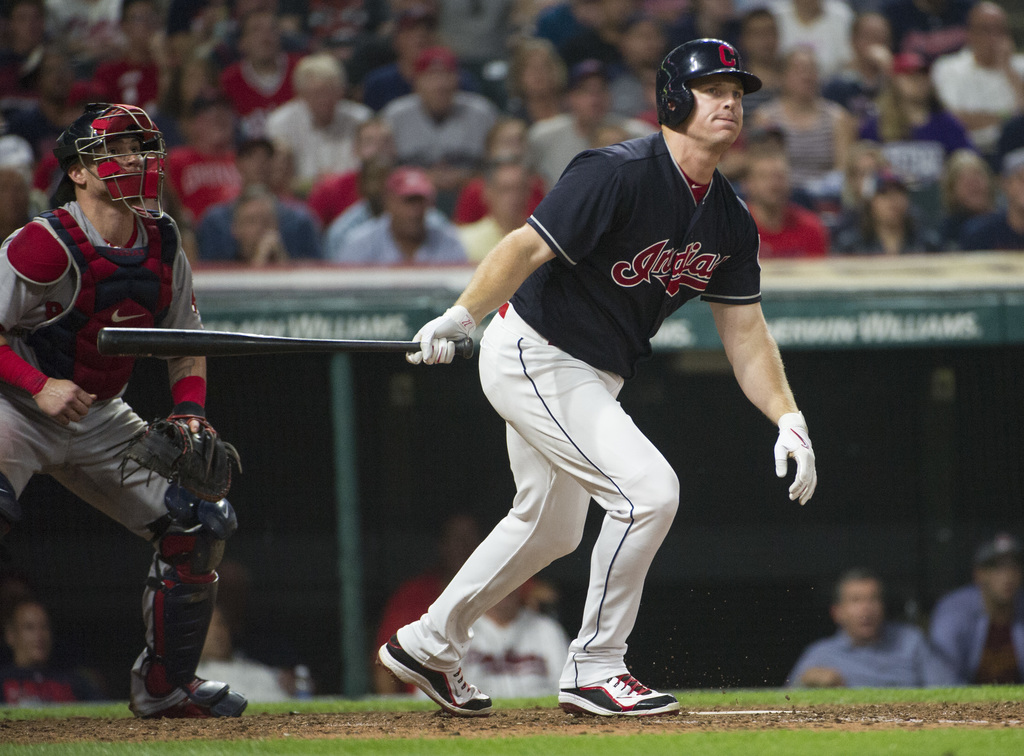 Cleveland Indians' Jay Bruce watches a foul ball along with Boston Red Sox' Christian Vasquez during the eight inning of a baseball game in Cleveland,...