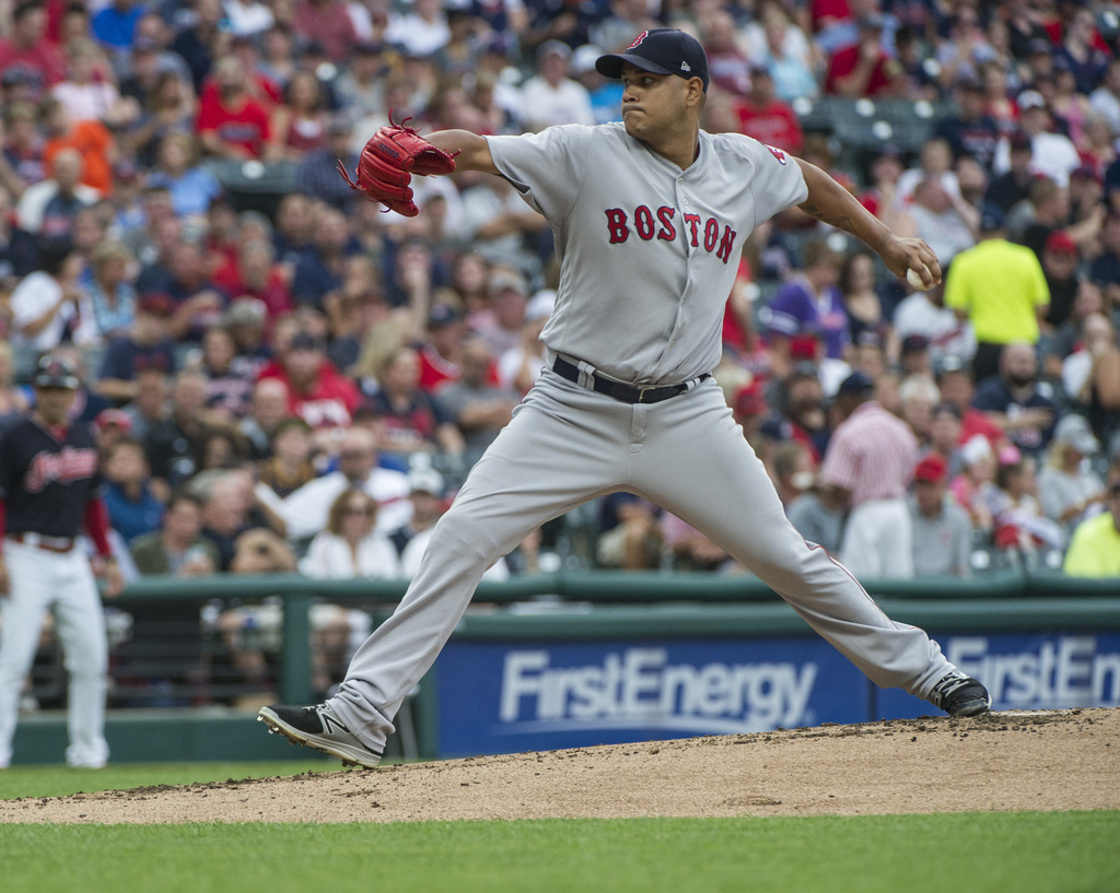 Boston Red Sox starting pitcher Eduardo Rodriguez delivers to Cleveland Indians' Francisco Lindor during the first inning of a baseball game in Clevel...