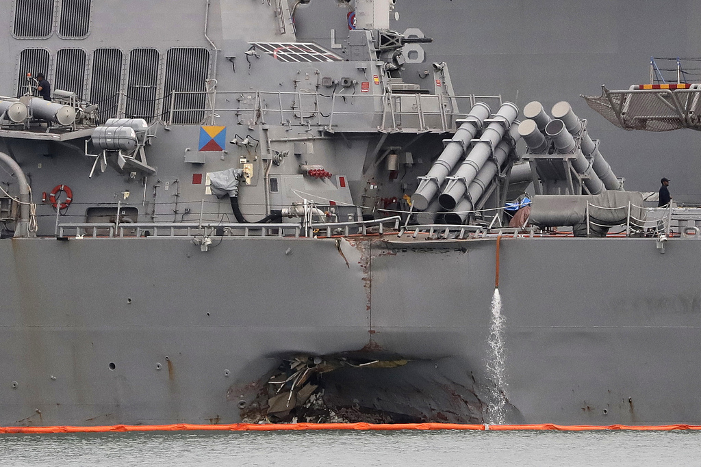 In this Tuesday, Aug. 22, 2017, filephoto, the damaged port aft hull of the USS John S. McCain, is visible while docked at Singapore's Changi naval ba...