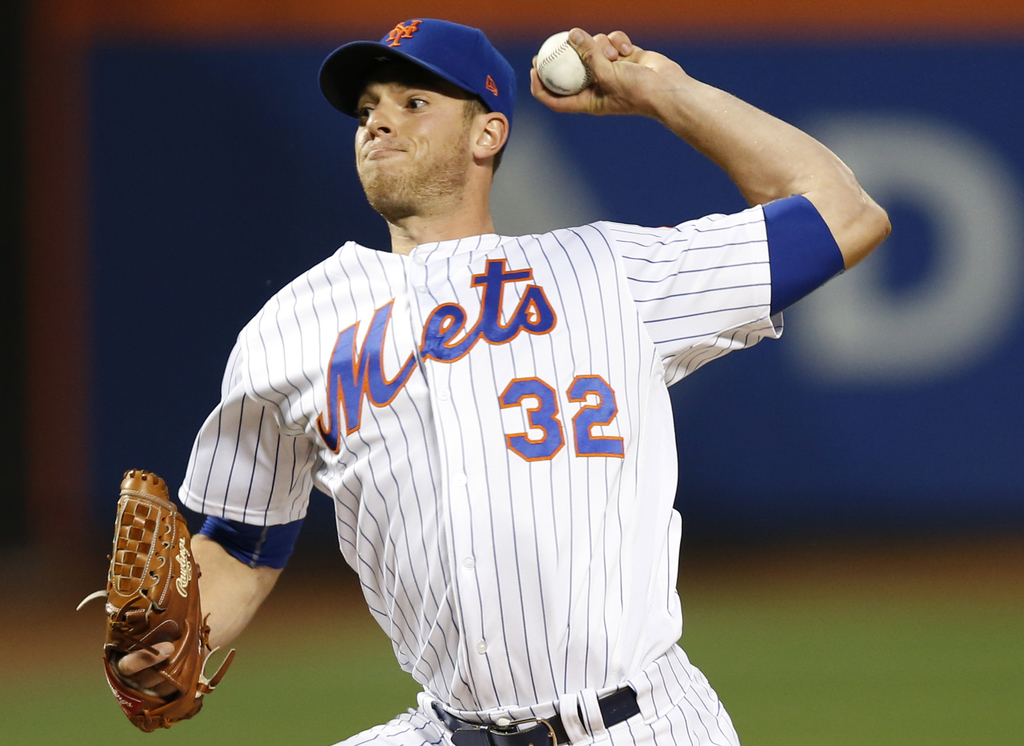 FILE - In this Sunday, Aug. 6, 2017 file photo, New York Mets starting pitcher Steven Matz winds up during the first inning of a baseball game against...