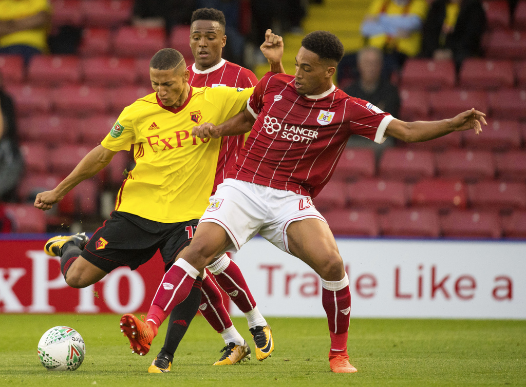 Watford's Richarlison, left, and Bristol City's Zak Vyner battle for the ball during the League Cup second round soccer match at Vicarage Road, Watfor...