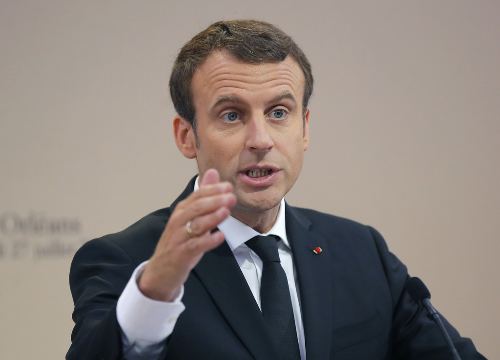 FILE - In this Thursday, July 27, 2017 file photo, French President Emmanuel Macron gestures as he delivers a speech during a citizenship ceremony in ...