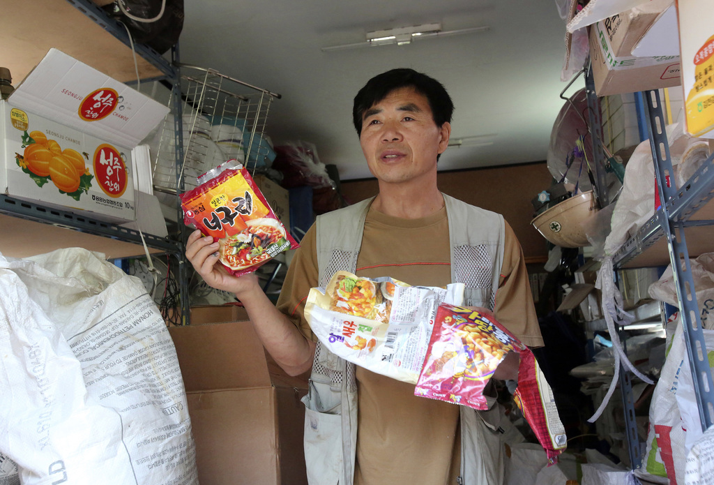 In this June 15, 2017 photo, Lee Min Bok, a North Korean who was swayed to flee his homeland when he stumbled across earlier generations of leaflets 3...