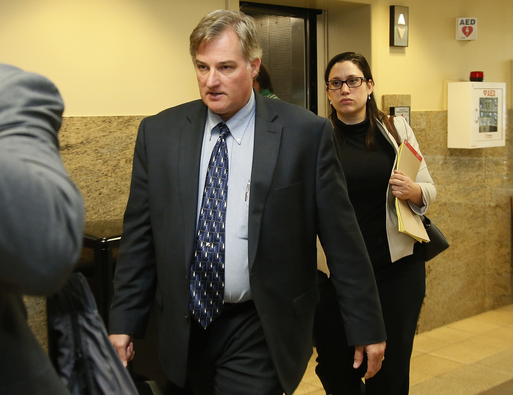 FILE - in this Friday, June 30, 2017, file photo, Shannon Kepler, left, arrives with his legal team for afternoon testimony in his third trial in Tuls...