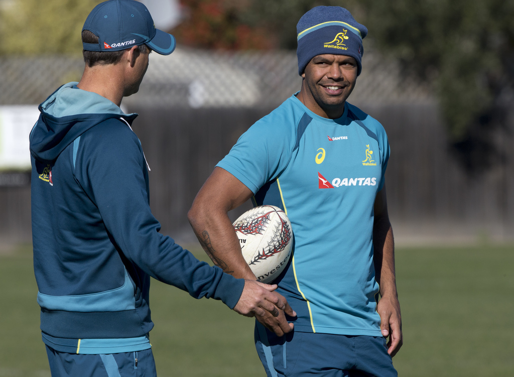 Australian inside centre Kurtley Beale talks with a team official during a training session in Christchurch, New Zealand, Thursday, Aug. 24, 2017. The...