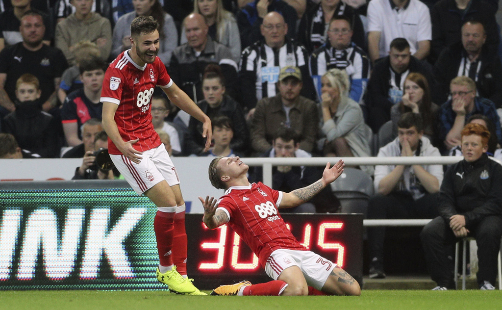 Nottingham Forest's Jason Cummings celebrates scoring against Newcastle United during the English League Cup second round match against Nottingham For...