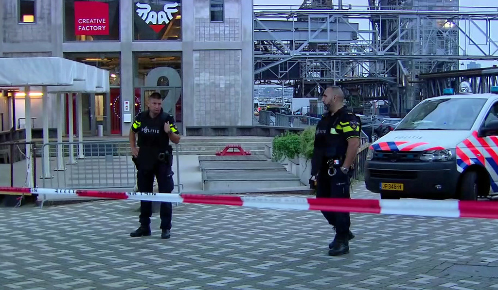In this image taken from video officers stand behind a cordoned-off area in Rotterdam Wednesday Aug. 23 2017 after a concert by an American rock