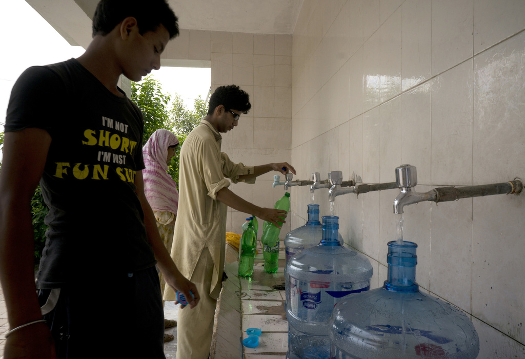 People at a filtration plant fill their bottles with water from a tube well, in Islamabad, Pakistan, Wednesday, Aug. 23, 2017. A new study suggests so...