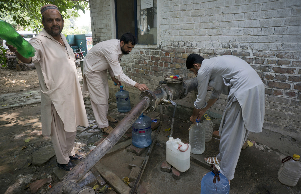 People collect water at a tube well in Islamabad, Pakistan, Wednesday, Aug. 23, 2017. A new study suggests some 50 million Pakistanis could be at risk...