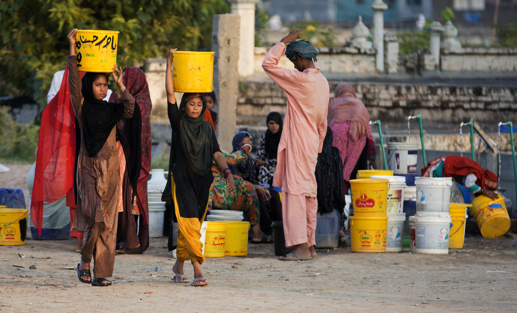In this Tuesday, Aug. 22, 2017 photo, people collect water for their families from a tube well, in Islamabad, Pakistan, Wednesday, Aug. 23, 2017. A ne...