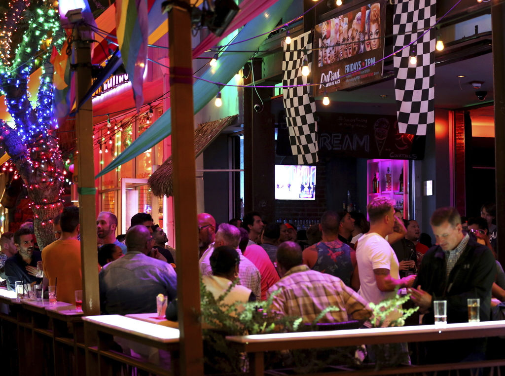 """In this June 23, 2017 photo, fans of """"RuPaul's Drag Race"""" attend a viewing party at Micky's West Hollywood in West Hollywood, Calif. Numerous gay bars..."""