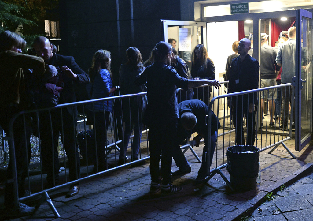 Spectators are checked by security guards as the enter a club for a concert by the American Allah Las rock band in Warsaw Poland Thursday Aug. 24