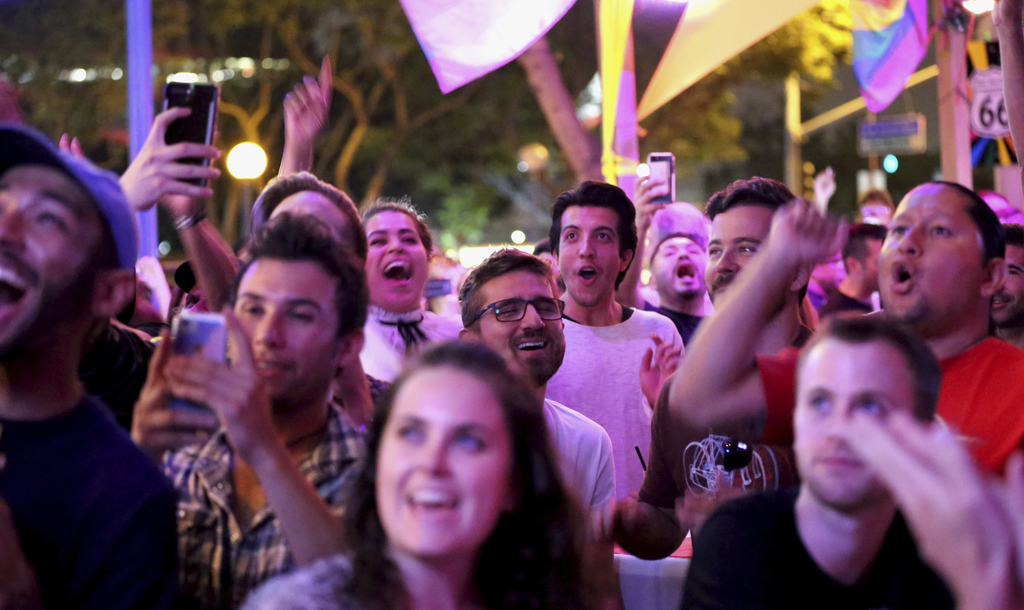 """In this June 23, 2017 photo, fans react to the season nine finale of """"RuPaul's Drag Race"""" during a viewing party at Micky's West Hollywood in West Hol..."""