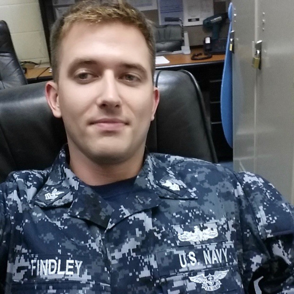 This undated photo provided by the U.S. Navy shows Electronics Technician 1st Class Charles Nathan Findley, of Missouri. Findley was stationed aboard ...